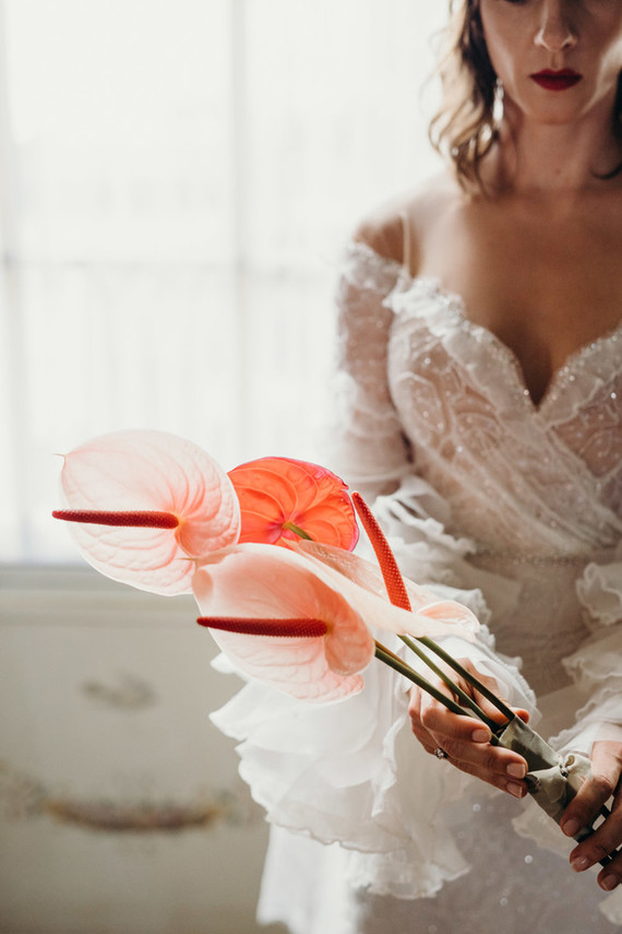 Her bouquet was very refined and done in blush and red