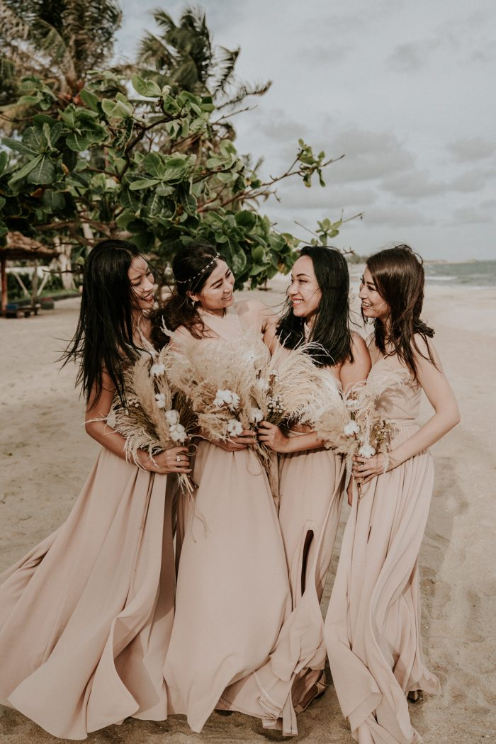 The bridesmaids were wearing mismatching blush maxi dresses