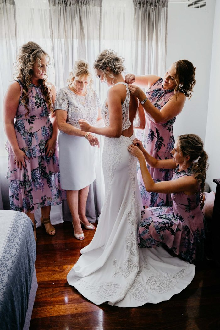 The bridesmaids were wearing pink floral midi dresses with layered skirts