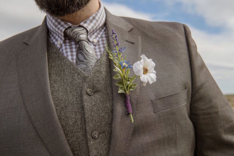 The groom was wearing a grey three-piece suit with a woolen waistcoat and a printed shirt