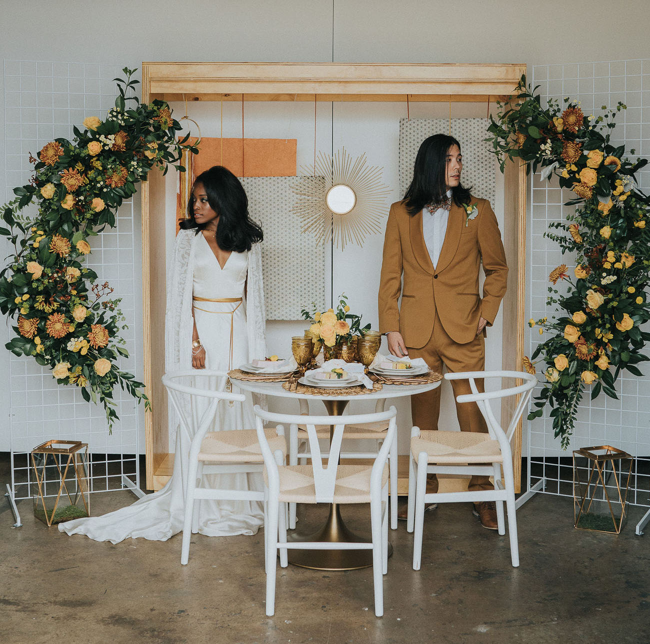 The reception space was done with rust and mustard blooms plus greenery
