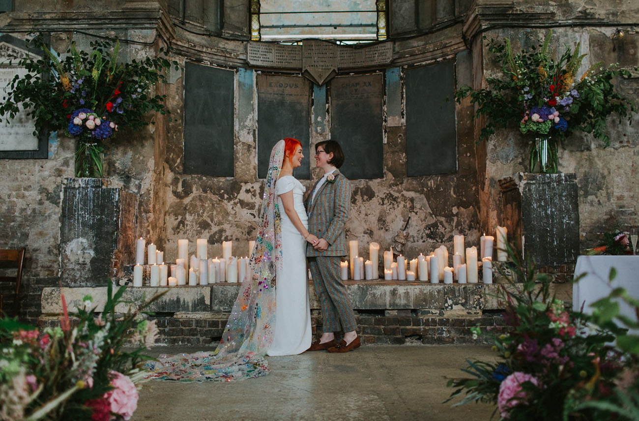 The wedding ceremony space was done with lots of pillar candles and lush and bold florals