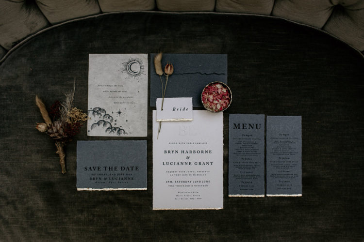 The wedding invitation suite was done in neutrals and grey, with a gold leaf edge
