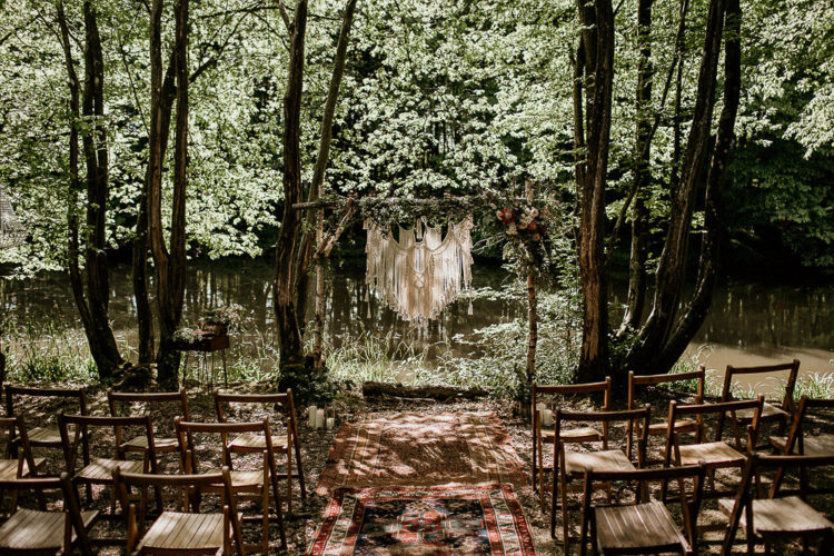 One wedding arch was made of branches, greenery and macrame and there were Persian rugs and candles around