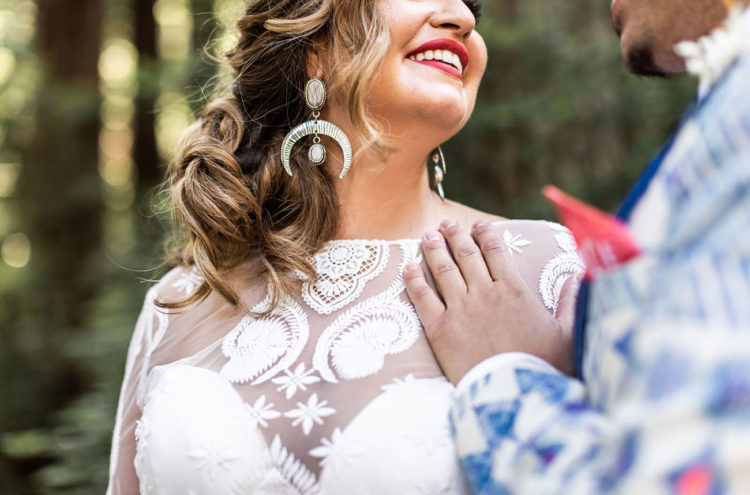 The bride accessorized her look with statement earrings