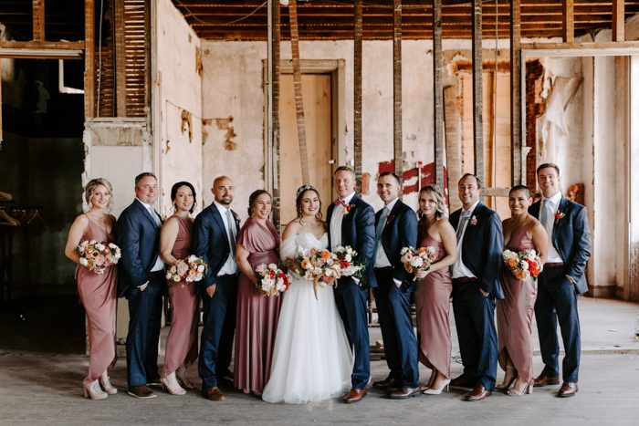 The groomsmen were wearing the same as the groom and the bridesmaids were rocking mauve maxi dresses