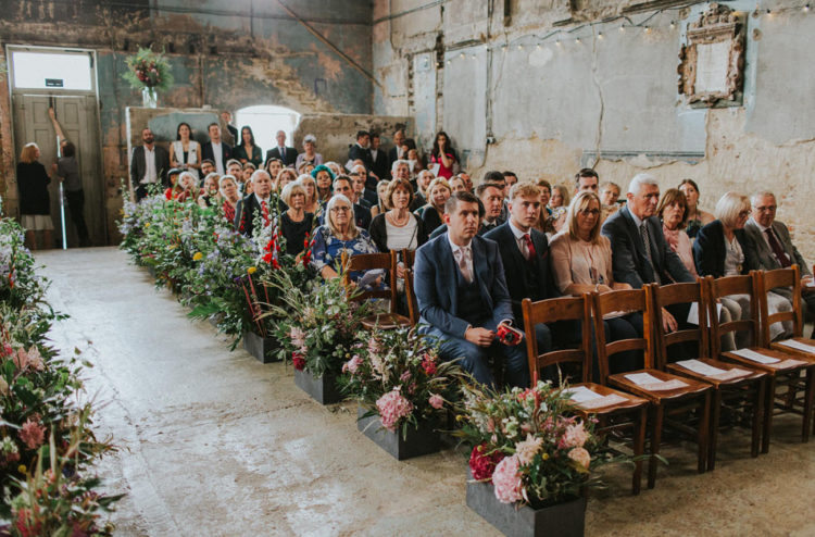 The wedding aisle was lined up with lush florals and lots of greenery
