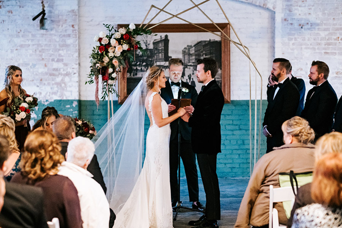 The wedding arch was a geometric one, with lush florals on one side
