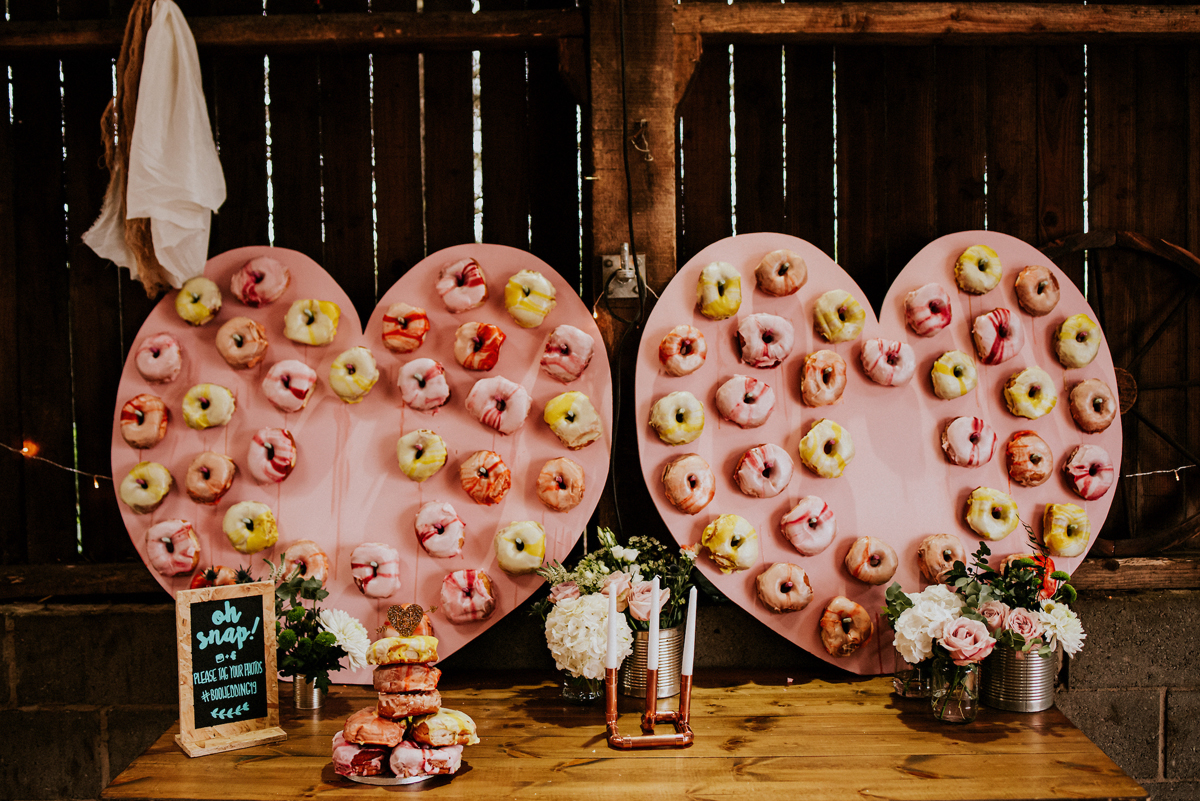 These heart donut walls were also DIYed by the brides themselves