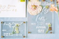 06 a chic wedding invitation suite with neutral pressed blooms and greenery is adorable for a natural or boho wedding