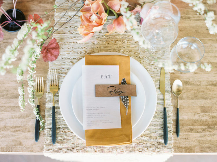 Each place setting was done with a fabric placemat, some elegant cutlery and chic rust and coral blooms