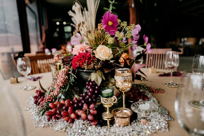 The centerpieces were done with lush florals and fresh fruits that could be eaten right from the table