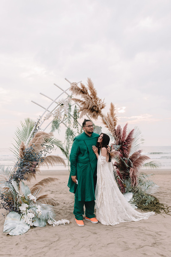 The groom was wearing a traditional emerald green suit and orange trainers