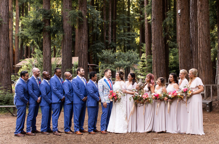 The groomsmen were wearign cobalt suits and the bridesmaids were rocking blush maxi dresses
