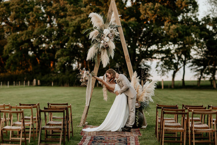 The second wedding arch was decorated with neutral blooms, pampas grass and foliage