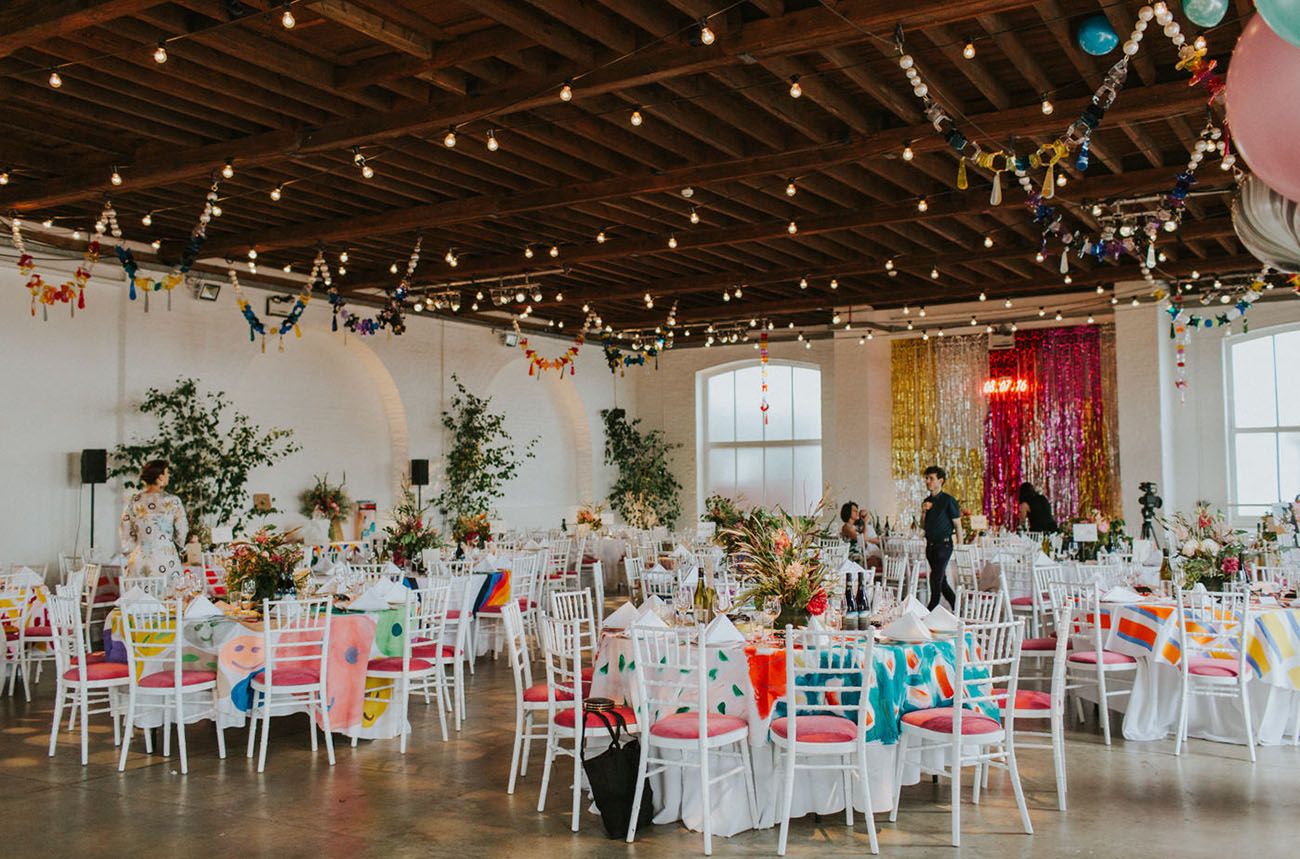 The wedding reception was super colorful and bright, with lots of lights and greenery