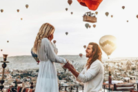 07 a very speactacular and cool proposal with a Moroccan-style picnic and lots of hot air balloons around