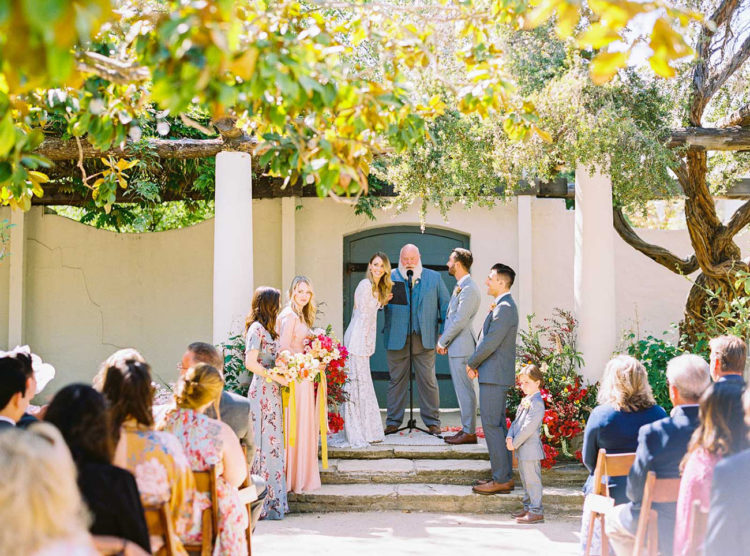 The ceremony space was done with lush and bright florals and much greenery