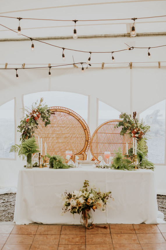 The sweetheart table was done with lots of greenery, ferns and blooms and candles