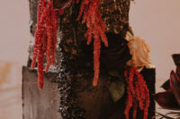 08 The wedding cake was a textural black one, with dark and red and orange blooms plus dried foliage