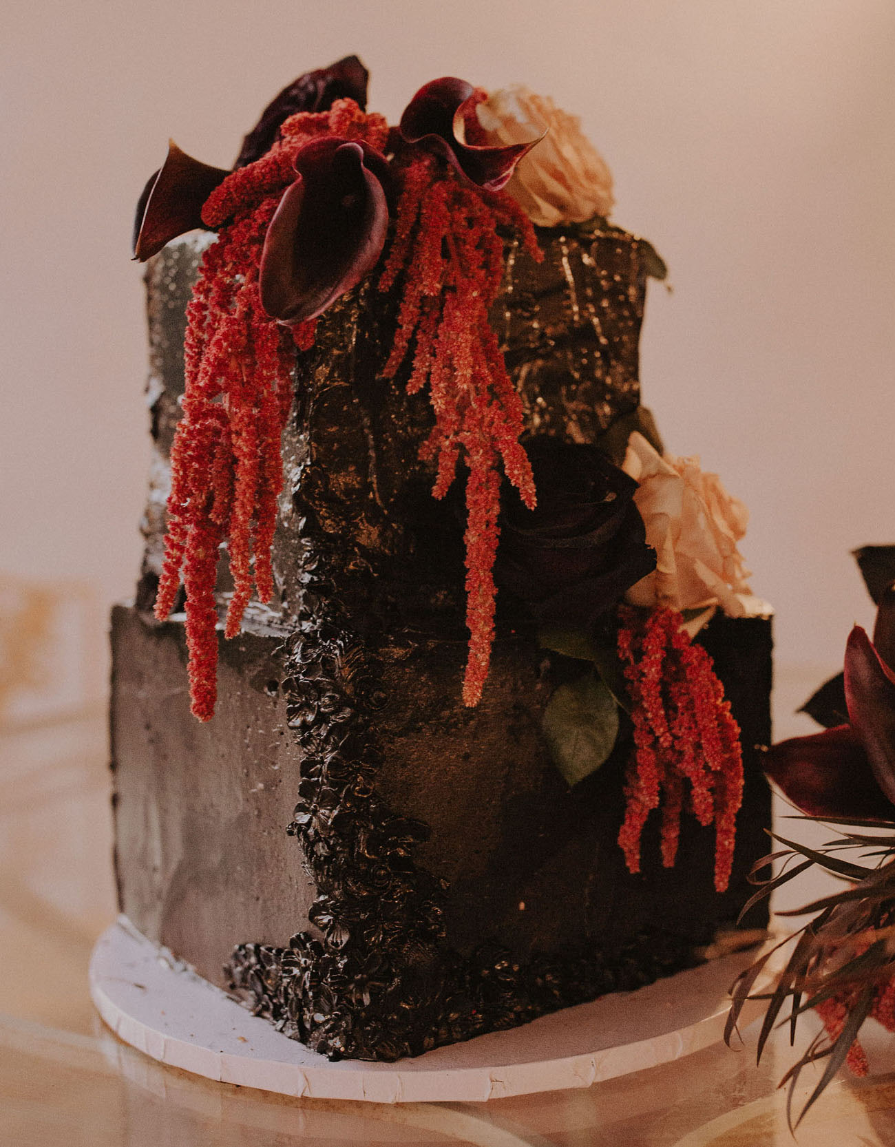 The wedding cake was a textural black one, with dark and red and orange blooms plus dried foliage