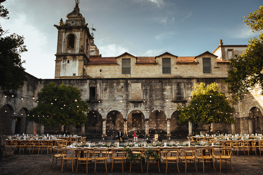 The wedding reception took place in the yard of the monastery, which was decorated with lights