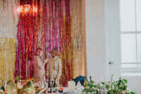 09 The wedding backdrop was super shiny in gold, copper and hot pink with a neon sign