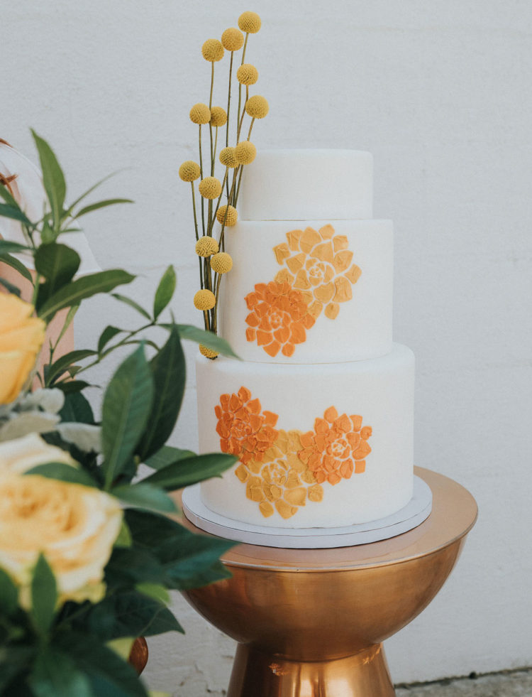 The wedding cake was a white one decorated with mustard and rust painted blooms