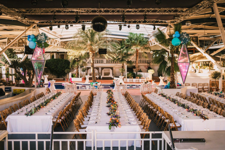 The wedding reception space was done with lots of balloons, tropical leaves and iridescent rhombes