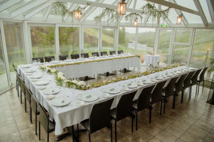 The wedding reception was in a glass house to enjoy the vies, and the decor was minimal - just some greenery over the table