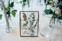 09 a pressed flower and greenery table number is a very natural and beautiful idea for a spring or summer wedding