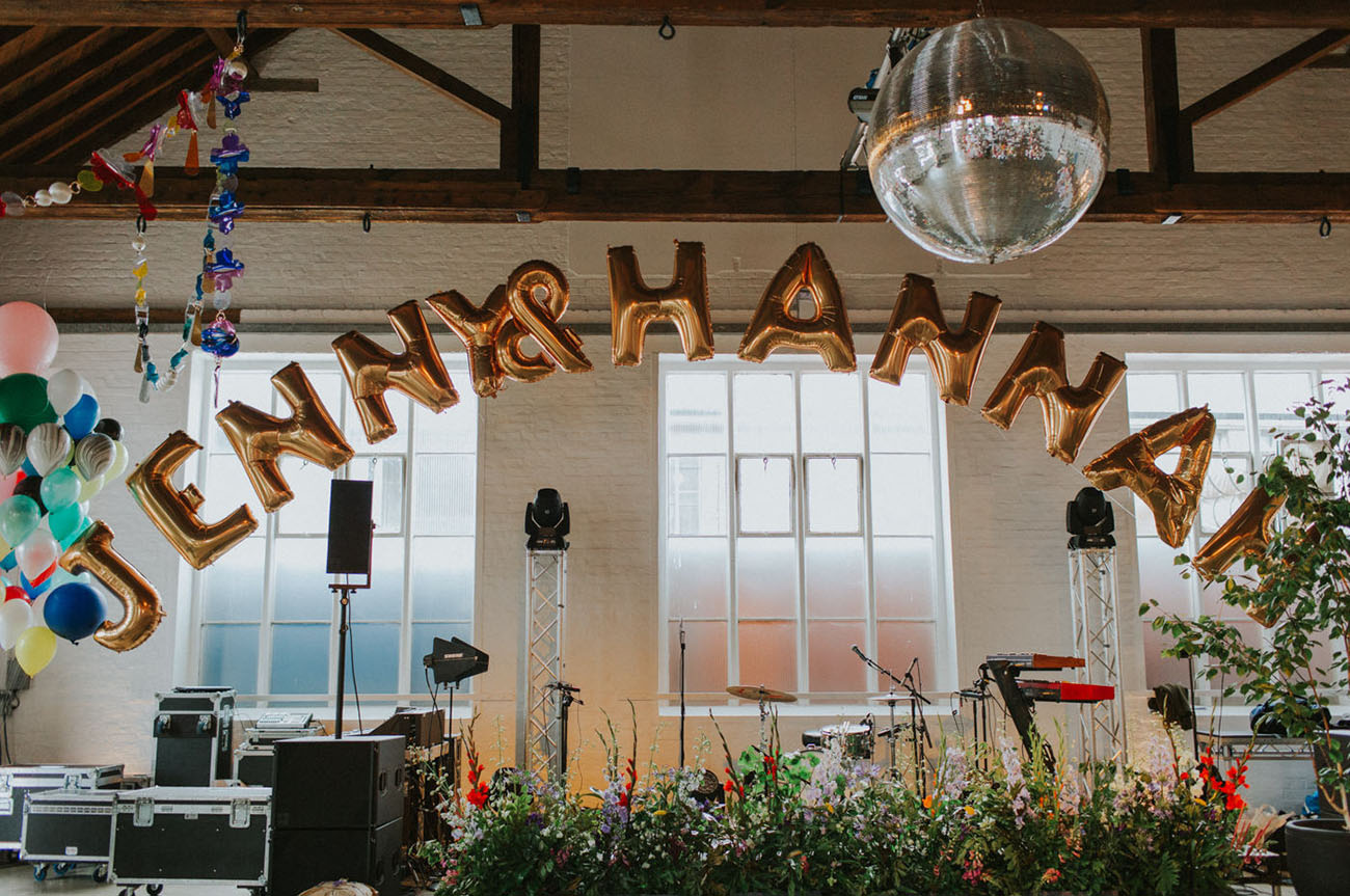 Lush florals were everywhere, and colorful balloons added a party feel to the reception
