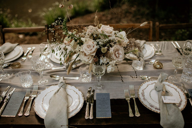 The second table was done neutral but mre refined, with elegant cutlery and a lush floral centerpiece