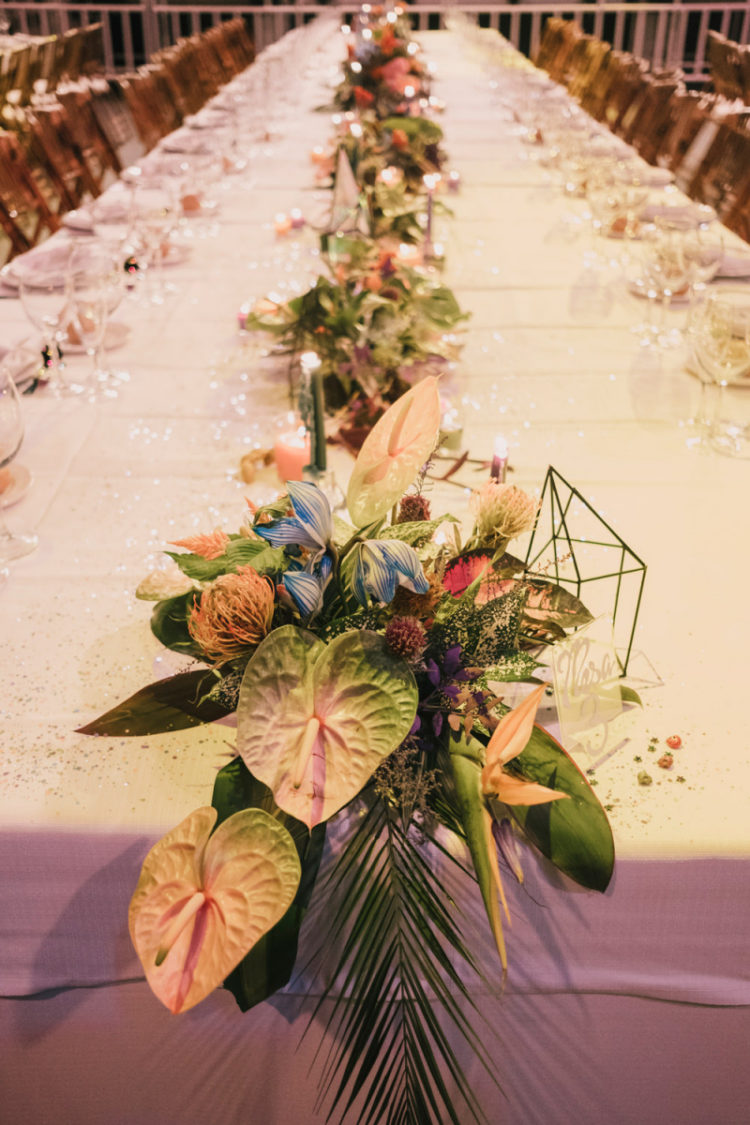 The table runners were done with greenery and foliage, with pastel blooms and candles