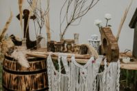 10 The wedding decor was done with wood, macrame, twigs, branches and wooden anchors