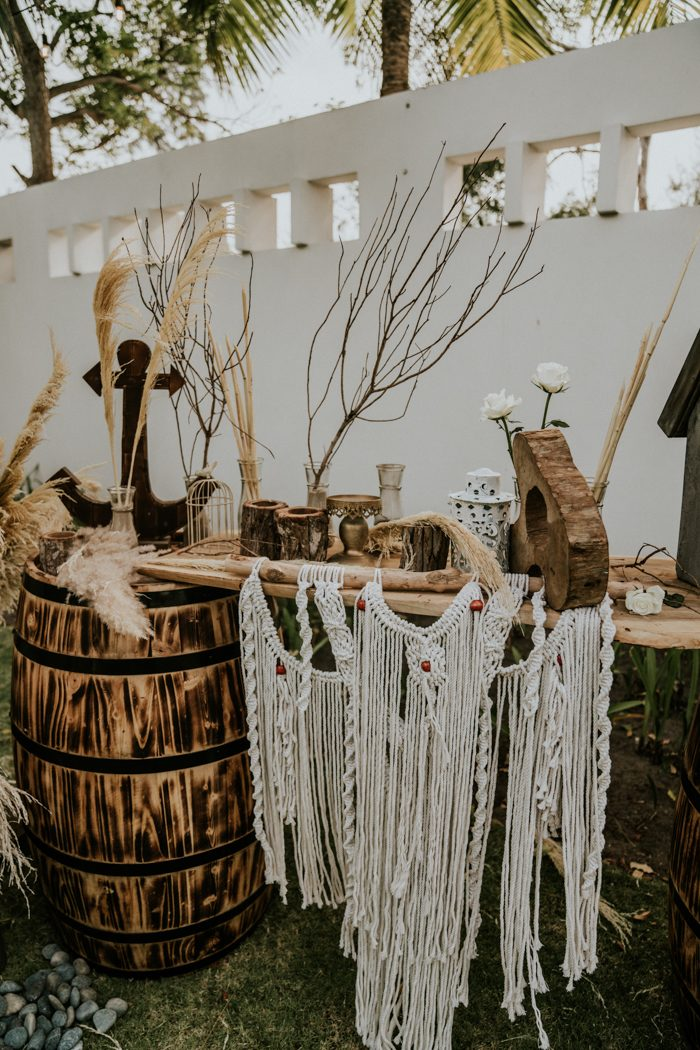 The wedding decor was done with wood, macrame, twigs, branches and wooden anchors