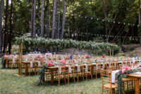 10 The wedding reception took place outdoors, with lights and greenery over the tables
