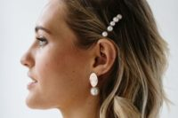10 a wavy bob with some pearl pins and matching gold and pearl earrings for a modern beach bride