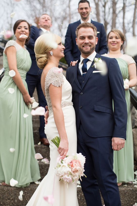 stylish and elegant looks with sage green maxi bridesmaid dresses and navy three-piece suits for groomsmen