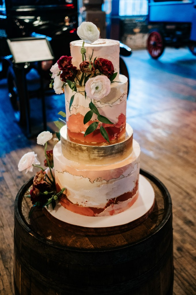 The wedding cake was a gradient one, in pink, coral and gold and with fresh blooms