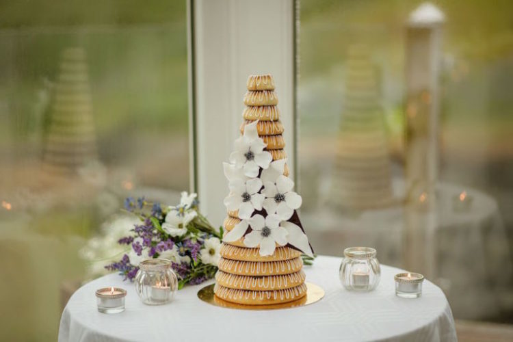 The wedding cake was a traditional kransekake decorated with white blooms