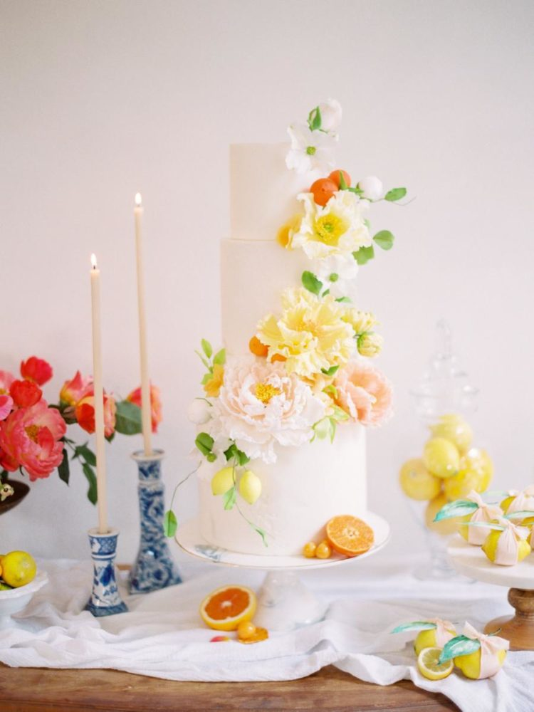 The wedding cake was a white one topped with edible sugar fruits and fresh blooms