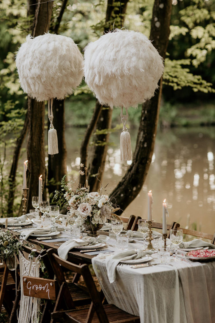 These cool fluffy balls with tassels over the table accent it a lot