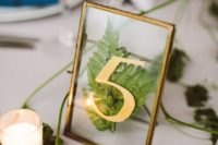 11 a stylish fern table number with gold and in a gold frame will be a nice and chic addition to your table