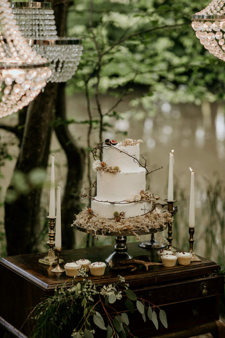 The wedding cake was a white one, topped with twigs, berries and a bit of blooms