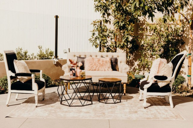 The wedding lounge was done outdoors and it was decorated in blush and black