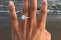 13 a classic round diamond white gold engagement ring with a halo is always in trend and will be loved by many people