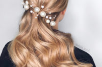 13 swept back wavy hair with assorted pearl pins looks very chic, refined and makes a stylish statement