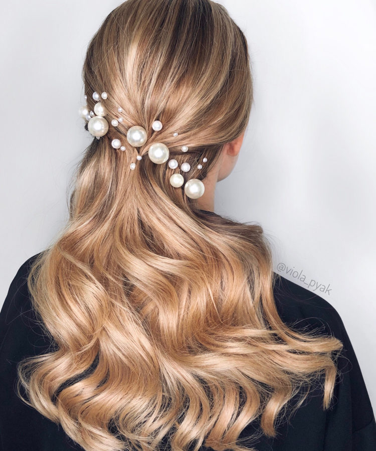swept back wavy hair with assorted pearl pins looks very chic, refined and makes a stylish statement