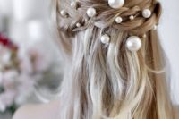 14 a romantic braided half updo with waves and an assortment of pearl pins looks very chic and very girlish